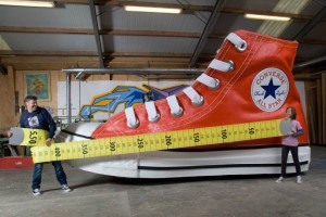 Largest Shoe Attempt Text The largest shoe measures 5.50 m (18 ft 0.53 in) x 2.11 m (6 ft 11.07 in) and is 2.90 m (9 ft 6.17 in) high and was unveiled by the Nationaal Fonds Kinderhulp (Netherlands) in Amsterdam, the Netherlands, on 17 November 2010, in celebration of Guinness World Records Day 2010. Further Info The largest shoe is an exact replica of a Converse Chuck Taylor All Star equivalent of a UK size 845. A Converse Chuck Taylor All Star European size 39 was used as a model for the largest shoe.